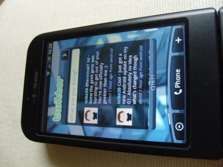 T-Mobile G1 with HTC Hero interface showing Twitter