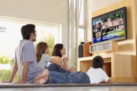 Family watching HDTV